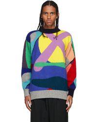 Sacai Pull multicolore en maille intarsia contrasté édition KAWS