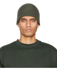 Lemaire Bonnet vert tricoté en laine