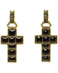Gucci Boucles doreilles noires et dorees Cross Pendant