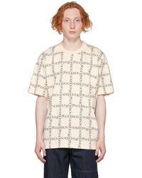 JW Anderson オフホワイト オールオーバー ロゴ オーバーサイズ T シャツ