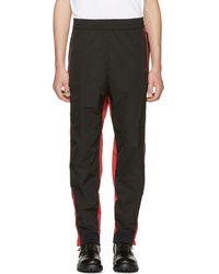 Ambush Pantalon de survetement rouge et noir