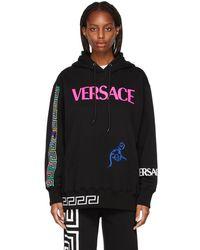 Versace ブラック オーバーサイズ ロゴ フーディ