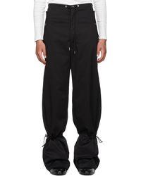 Dion Lee Pantalon parachute noir à œillets et attaches