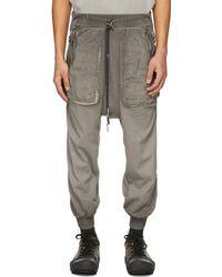 Boris Bidjan Saberi Pantalon de survêtement teint en résine gris