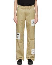 Rassvet (PACCBET) Pantalon beige à écussons graphiques - Neutre