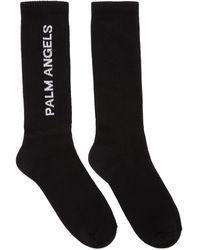 Palm Angels Chaussettes noires Vertical Logo