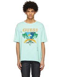 Alchemist T-shirt bleu à logo édition Guess
