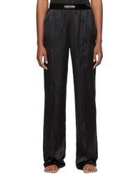 Tom Ford Pantalon de survêtement de style pyjama noir en soie