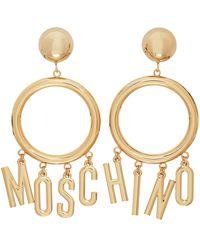Moschino ゴールド ロゴ フープ クリップオン イヤリング - メタリック