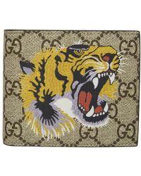 Gucci Portefeuille Suprême GG à imprimé tigre - Neutre