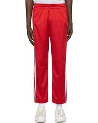 adidas Originals レッド Firebird トラック パンツ