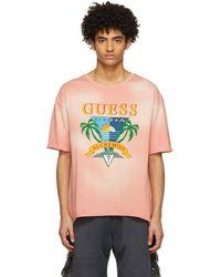 Alchemist T-shirt rose à logo édition Guess