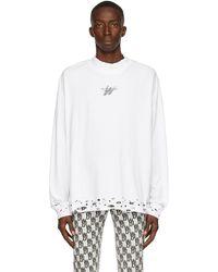 we11done T-shirt à manches longues à effet uséà logo - Blanc