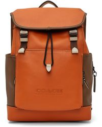 COACH オレンジ & ブラウン League Flap バックパック
