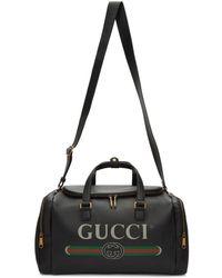 Gucci ブラック ロゴ プリント ダッフル バッグ