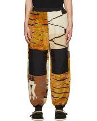 Aries Pantalon de survêtement orange et blanc cassé en molleton