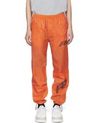 Filling Pieces Pantalon de survetement en nylon orange Cord