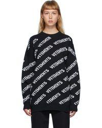 Vetements ブラック オールオーバー ロゴ クルーネック セーター