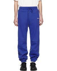 ADER error Pantalon de survetement bleu Incision