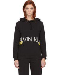 Calvin Klein 限定エディション ブラック ネオン フーディ