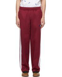Maison Kitsuné Pantalon de survêtement bourgogne t7 édition puma - Rouge