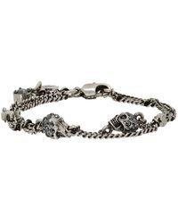 Alexander McQueen Bracelet à chaîne gris acier Multi Skull - Métallisé