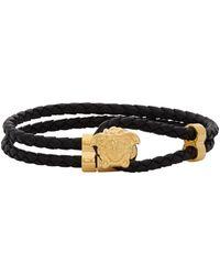 Versace Bracelet noir et doré Medusa