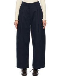 Studio Nicholson Pantalon ample Dordoni bleu marine à plis