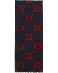 Gucci Foulard en maille jacquard bleu et rouge GG
