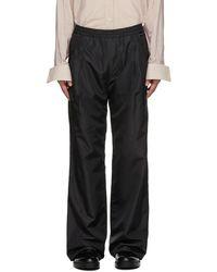 Y. Project Pantalon ample noir en taffetas