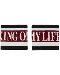 Dolce & Gabbana Serre-poignets rouges et noirs King Of My Life