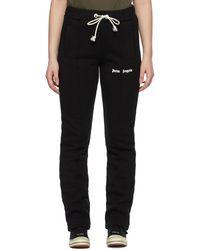 Palm Angels Pantalon de survêtement ajusté à logo noir