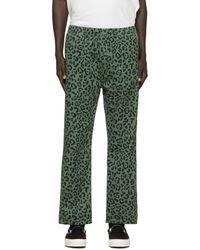 Vyner Articles Pantalon de survetement a motif leopard vert Chaos