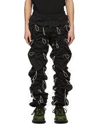 99% Is Pantalon de survêtement noir et blanc Gobchang