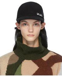 Sacai Casquette noire en laine melton édition KAWS