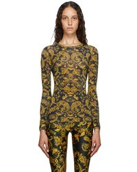 Versace Jeans Black And Gold Paisley Print Leggings - Multicolour