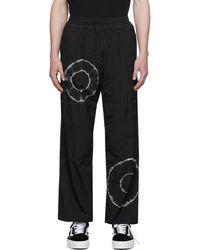 Aries Pantalon de survêtement coupe-vent noir à motif tie-dye