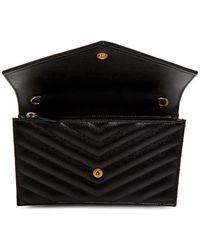 Saint Laurent - Sac portefeuille enveloppe a chaine noir Monogramme - Lyst
