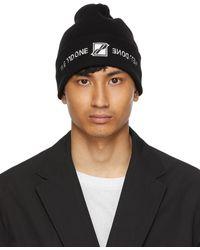 we11done Bonnet noir à logo brodé