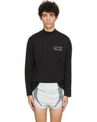 Martine Rose T-shirt à manches longues noir à col cheminée et logo exclusif à SSENSE