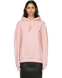 we11done Pull à capuche et logo brodé rose
