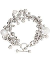 Acne Studios Bracelet argenté à breloques et à perles - Métallisé