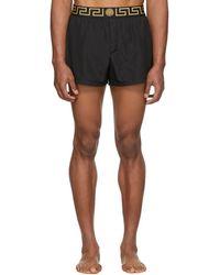 Versace - Black Greek Key Border Swim Shorts - Lyst