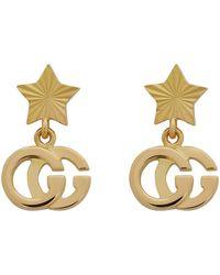 Gucci Boucles d'oreilles pendantes dorées GG Running Star - Métallisé