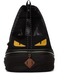 Fendi Sac à dos convertible noir et jaune Bag Bugs