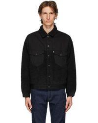 Levi's ブラック シェルパ オーバーサイズ トラッカー ジャケット
