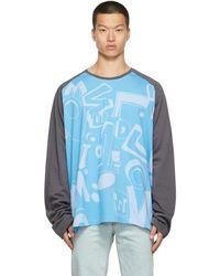 we11done T-shirt à manches longues à motif à logo - Bleu