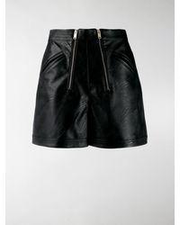 Stella McCartney Shorts aus Kunstleder - Schwarz