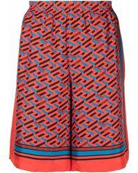 Versace Shorts aus Seide mit Greca-Print - Orange