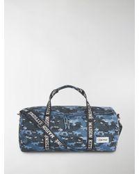 Maison Kitsuné - X Eastpak Camouflage Print Duffle Bag - Lyst 9bb196cf95